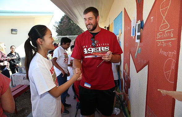 TE Garrett Celek partners with a Cabrillo Middle School student to tackle some math equations.