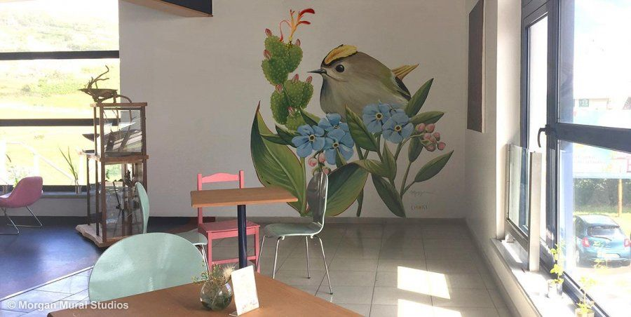 I painted this Goldcrest on a wall at the airport café, Café das Flores.